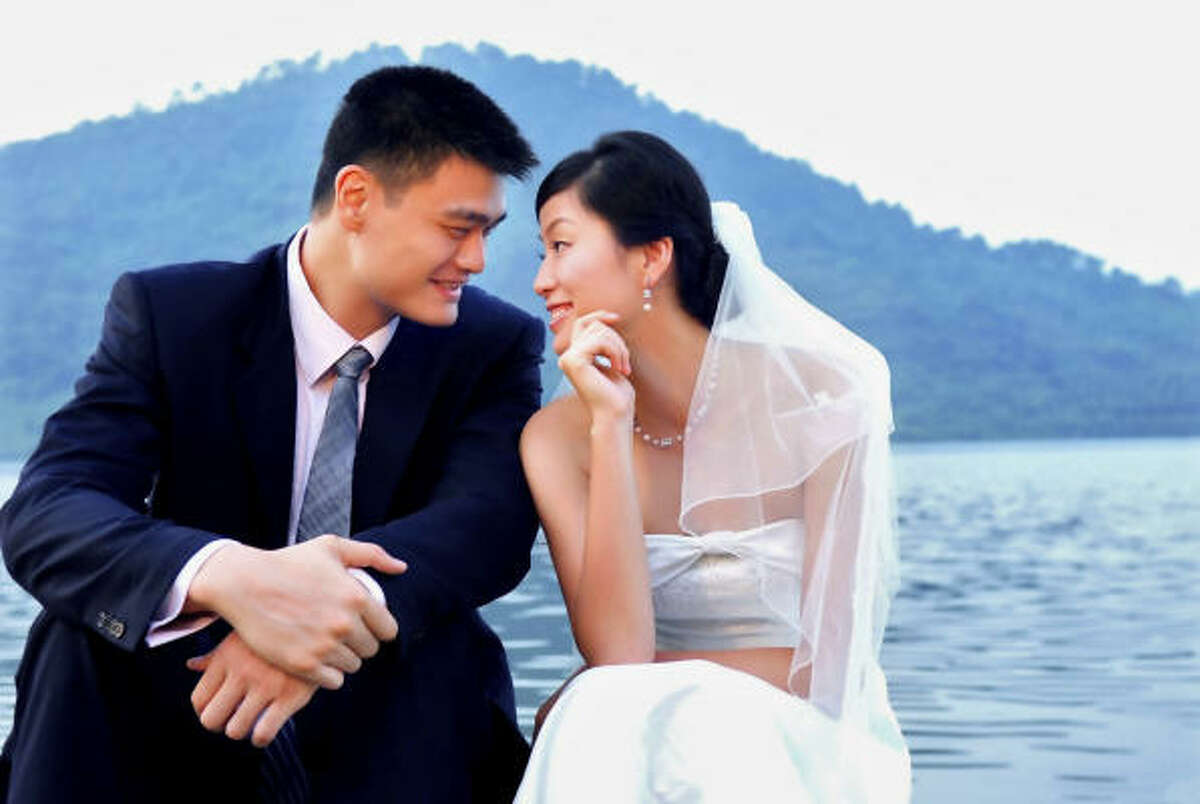 Yao Ming and Ye Li share a picture perfect moment in this wedding photo taken in Linan, China.