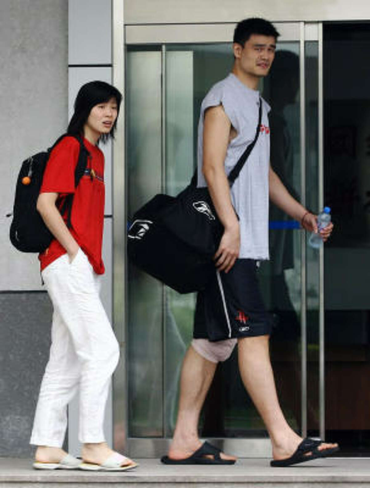 A recent undated photo of Yao Ming, who has kept his love life closely guarded from the media, with his teenage sweetheart Ye Li, in Beijing. Yao and Ye will wed today, after an eight-year courtship, in a family-only ceremony in Shanghai, where they were born, met and began dating.