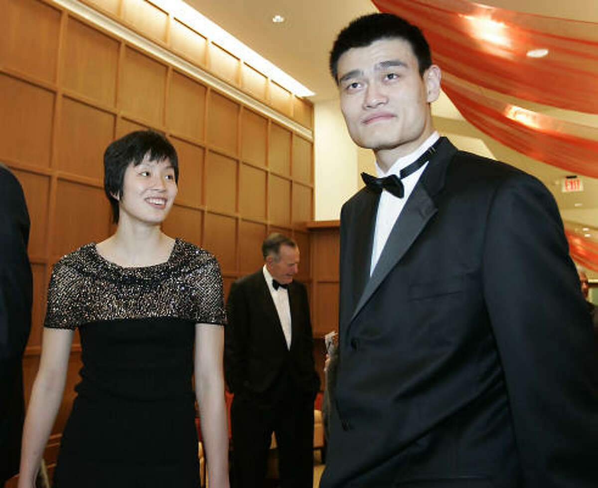 Rockets center Yao Ming stands with his date Ye Li during a VIP party before the Houston Rockets Clutch City Foundation's Tux & Tennies Charity Gala March 3, 2005 at the Toyota Center in Houston.