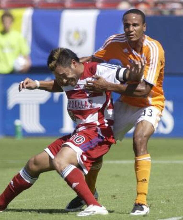 Dynamo midfielder Ricardo Clark, right will miss the rest of the season and the MLS playoffs due to suspension after deliberately kicking FC Dallas forward Carlos Ruiz in retaliation for a foul in Sunday's 3-0 win by the Dynamo. Photo: Juan Garcia, AP