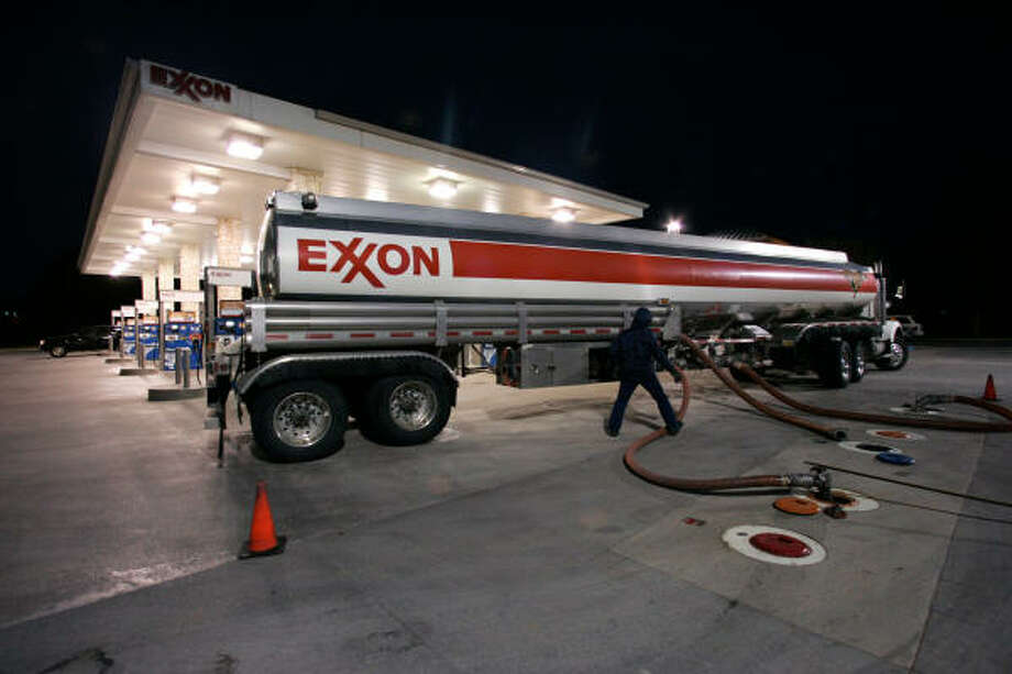 A worker delivers fuel to an Exxon station in Keller, Texas. Photo: Donna McWilliam, AP