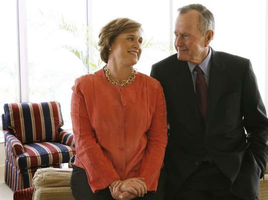 President George W. Bush praises his father in an interview with sister Doro Bush Koch, shown in 2005 with the former president. Photo: Kevin Fujii, CHRONICLE FILE