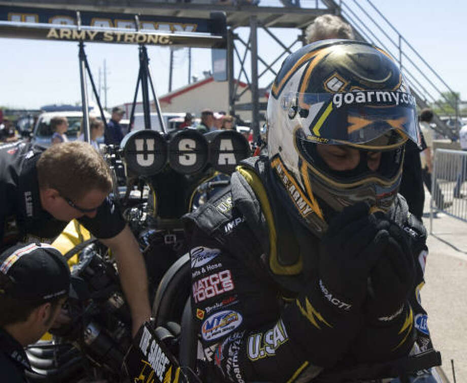Top Fuel winner Tony Schumacher squeezes into the cockpit of his dragster before an elimination run during Sunday's NHRA O'Reilly Spring Nationals at Houston Raceway Park. Photo: James Nielsen, Chronicle