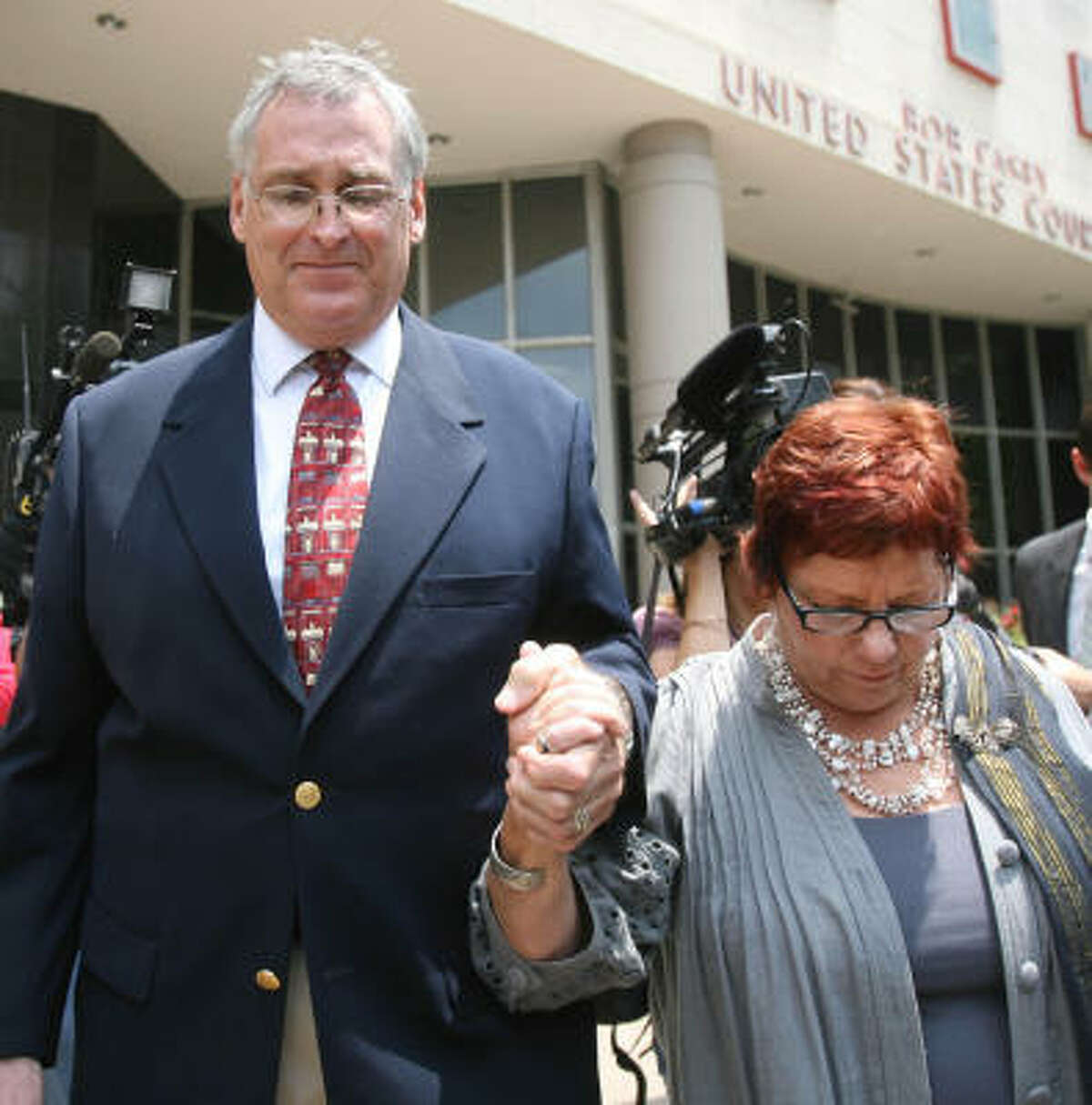 U.S. District Court Judge Samuel B. Kent is shown with his wife, Sarah, in May. He was charged with trying to cover up sexual assaults on two female employees.