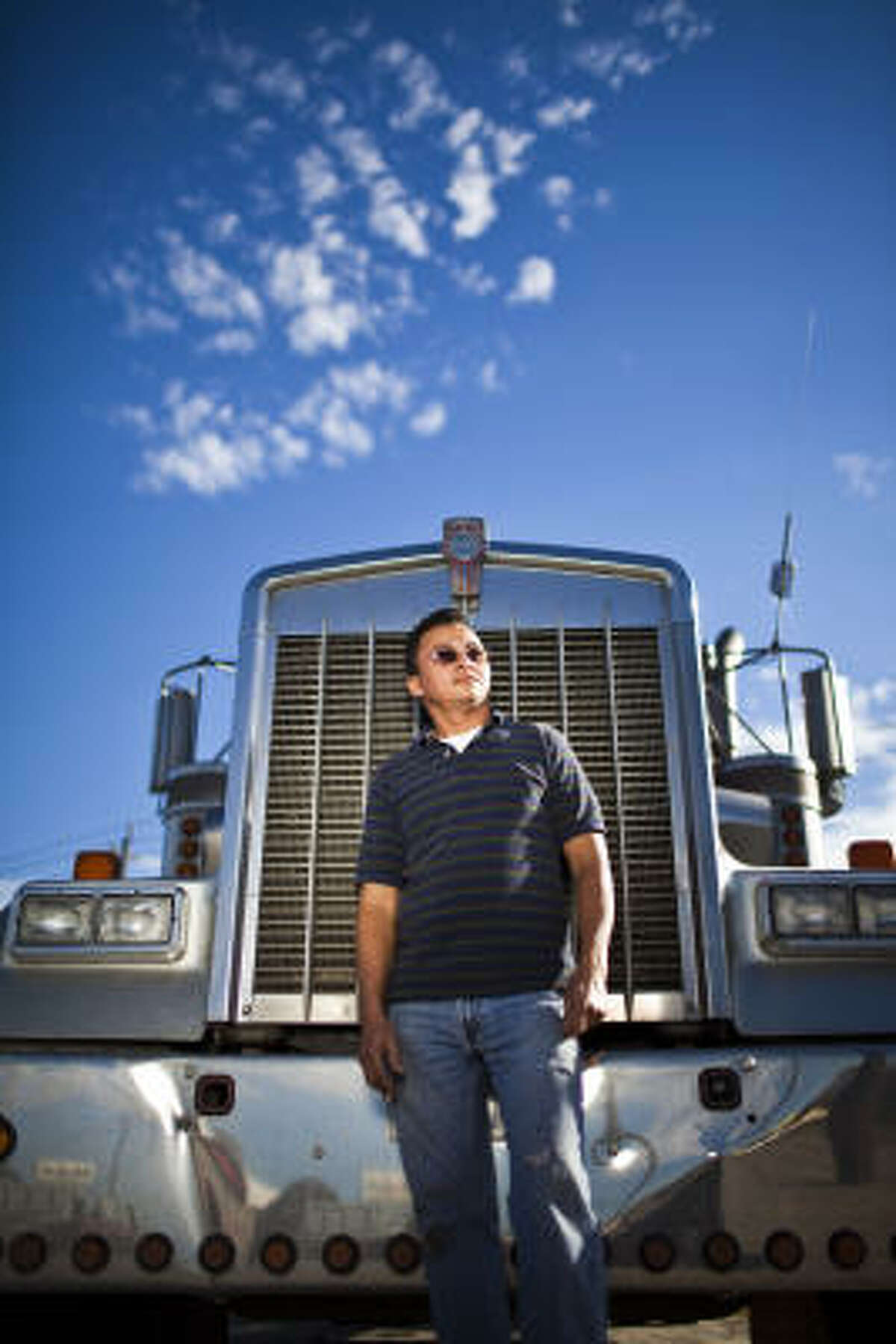 Salvador Gutierrez, a native of El Salvador, said he has built a modest but prosperous life in Houston with the money he earns driving his Kenworth 18-wheel truck. But his livelihood is threatened now, he said, by a recent decision by the Department of Public Safety to revoke the commercial driver's licenses of immigrants who lack certain immigration documents -- even though they are legally authorized to work in the United States. The controversy centers on a change to the Texas Transportation Code enacted in 2007, but only recent enforced by DPS, said Bianca Santorini, an attorney with Houston's American for All, an immigrant advocacy organization. The change jeopardizes the commercial licenses of thousands of immigrants granted Temporary Protected Status, or TPS, a kind of temporary reprieve from deportation generally reserved for countries ravaged by natural disasters or destabilized by war, Santorini said.