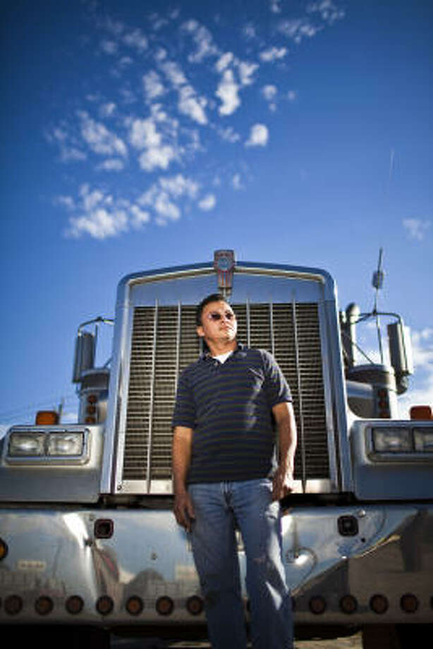 Salvador Gutierrez, a native of El Salvador, said he has built a modest but prosperous life in Houston with the money he earns driving his Kenworth 18-wheel truck. But his livelihood is threatened now, he said, by a recent decision by the Department of Public Safety to revoke the commercial driver's licenses of immigrants who lack certain immigration documents -- even though they are legally authorized to work in the United States. The controversy centers on a change to the Texas Transportation Code enacted in 2007, but only recent enforced by DPS, said Bianca Santorini, an attorney with Houston's American for All, an immigrant advocacy organization. The change jeopardizes the commercial licenses of thousands of immigrants granted Temporary Protected Status, or TPS, a kind of temporary reprieve from deportation generally reserved for countries ravaged by natural disasters or destabilized by war, Santorini said. Photo: Eric Kayne, For The Chronicle