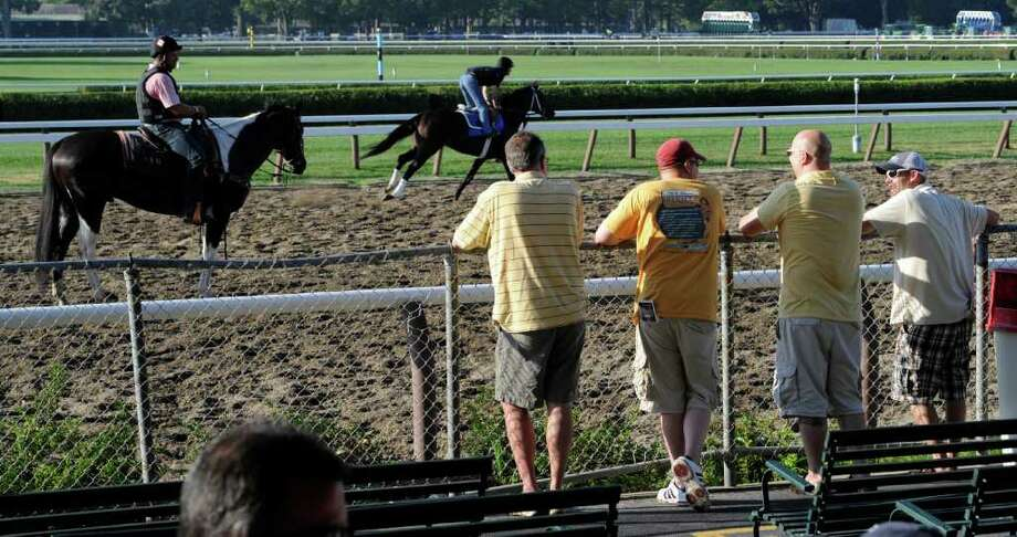 It's the 143rd opening day at the Saratoga Race Course and people are enjoying the breakfast and the morning workouts at the track  July 22, 2011.  (Skip Dickstein / Times Union) Photo: SKIP DICKSTEIN / 2011