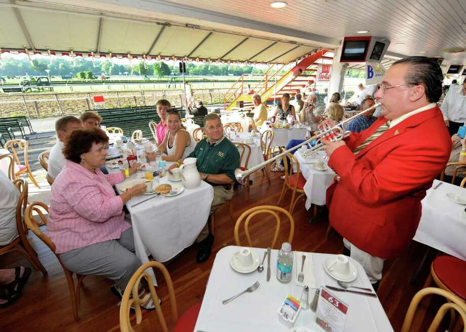 "Sam ""The Bugler"" Grossman serenades the breakfast crowd on opening day at the Saratoga Race Course  July 22, 2011.  (Skip Dickstein / Times Union) Photo: SKIP DICKSTEIN / 2011"