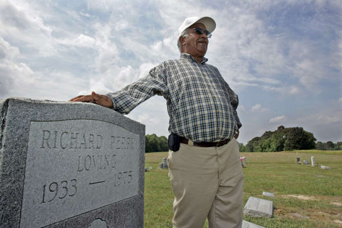 Edward Clarke stands next to the gravestone of his friend Richard Perry Loving in Sparta, Va. Loving, a white man, married Mildred Jeter, a black woman, and the couple lived in segregated Virginia. They were convicted under the state's law prohibiting interracial unions, but ultimately the U.S. Supreme Court ruled in their favor.