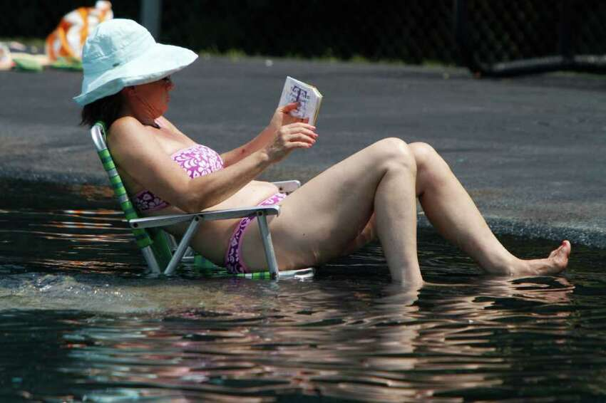 A woman enjoys the cool of the pool on Wednesday, July 20, 2011 in Montpelier, Vt.