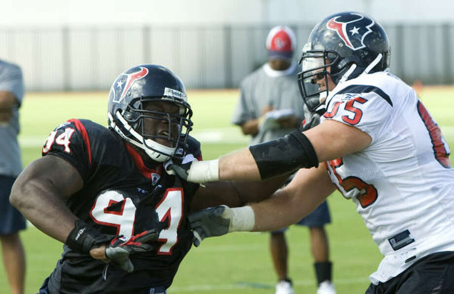 Texans defensive end N.D. Kalu (94) runs through a pass rush drill against guard Mike Brisiel (65) during Texans training camp. Kalu says he's not ready to let football go but will stay in Houston if he doesn't survive final roster cuts. Photo: Brett Coomer, Houston Chronicle