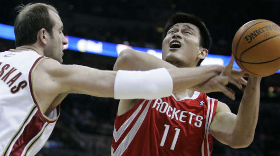 Yao Ming had 16 points and 11 rebounds in 27 minutes. Photo: Tony Dejak, AP