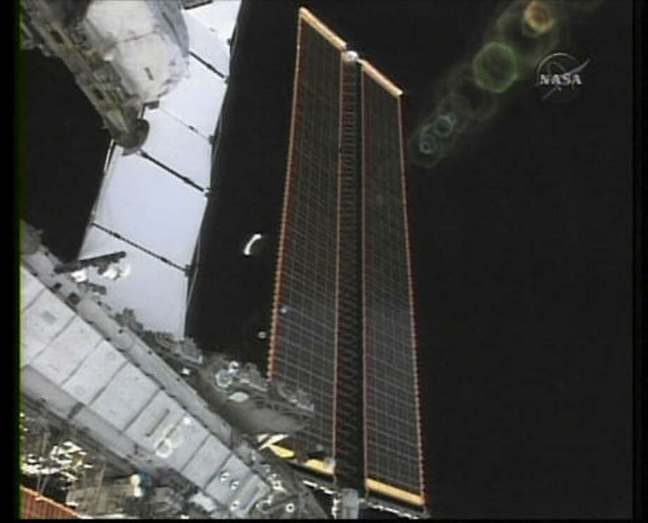 A new set of solar panels are fully unfurled outside the international space station orbiting Earth Tuesday. Photo: AP / NASA-TV