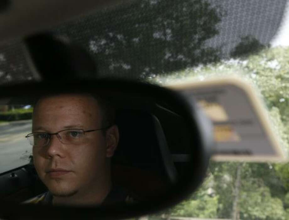 Kyle Bigelow, who has an EZ Tag on the windshield behind his rearview mirror, says he already spends $1,200 a year on Westpark tolls and can't afford to spend $2,400 to $3,000. Photo: MELISSA PHILLIP, CHRONICLE