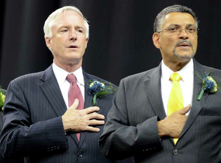 Ed Joyner, Mayor Bill Finch and Superintendent of Schools John Ramos recite the Pledge during the 2011 Warren Harding High School Commencement at Webster Bank Arena in Bridgeport on Monday, June 20, 2011. Photo: Amy Mortensen, ST / Connecticut Post Freelance