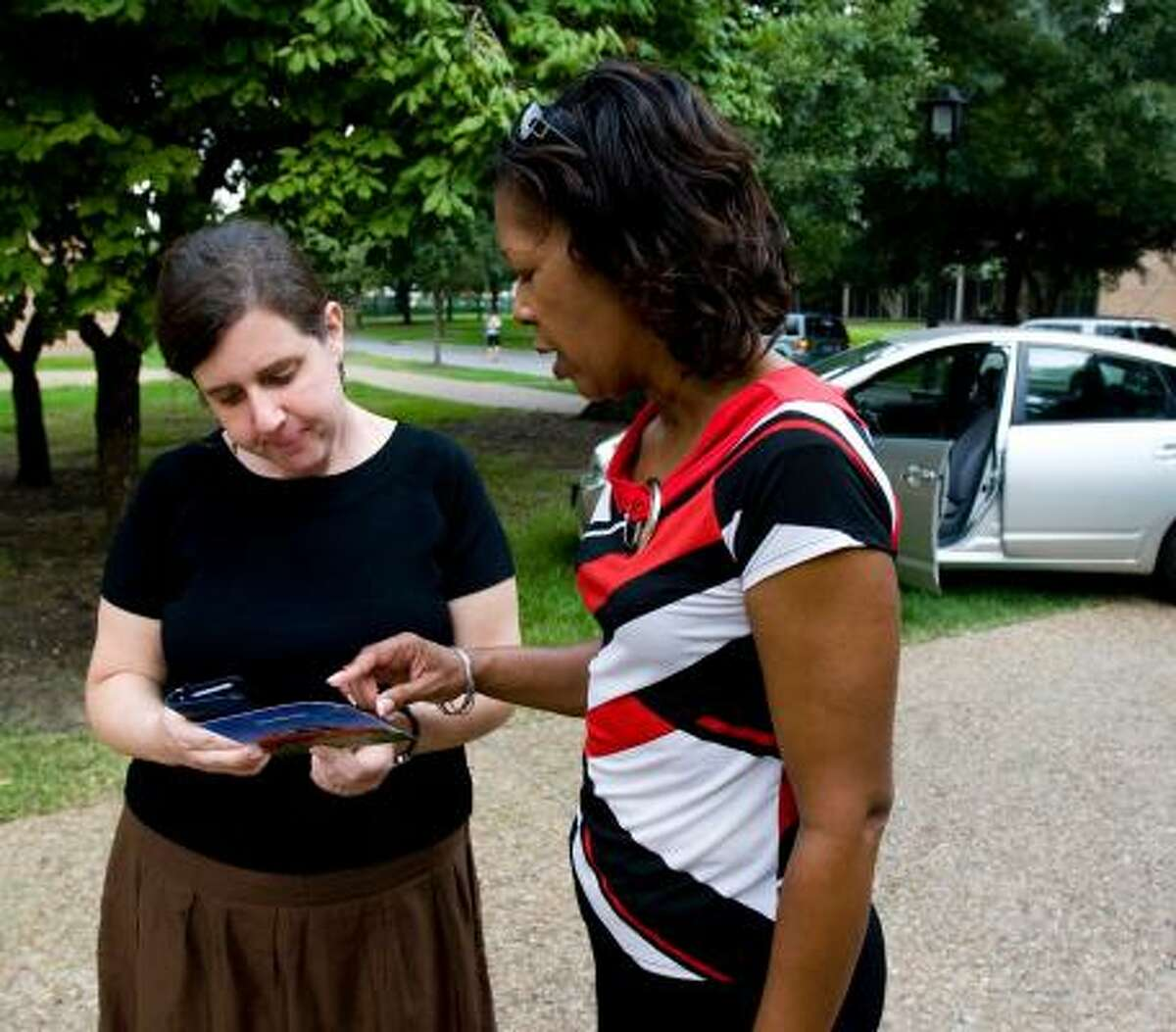 Cynthia Booker, right, explains the Zipcar program to Lisa Birenbaum of Rice University's department of transportation and parking. Zipcar made its Texas debut on Tuesday.