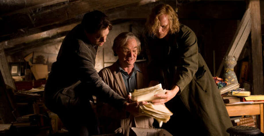 Mo (Brendan Fraser), from left, Fenoglio (Jim Broadbent) and Dustfinger (Paul Bettany) discover Fenoglio's original manuscript in the fantasy-adventure Inkheart, the story of supernaturally gifted readers who can bring a story to life by reading it aloud. Photo: Murray Close, New Line Cinema