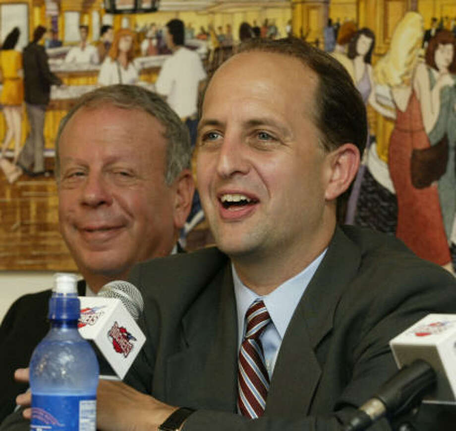 In brighter days, Rockets owner Leslie Alexander, left, helps introduce newly hired Jeff Van Gundy to Houston media in 2003. Photo: D. Fahleson, Houston Chronicle
