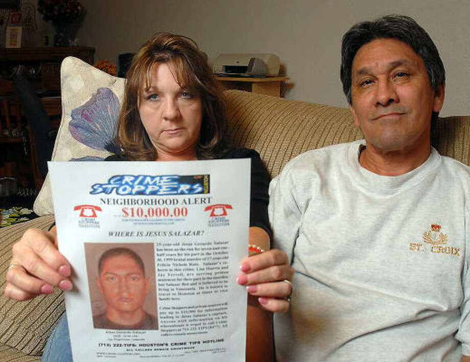 Lucio and Carrie Ruiz hold a wanted poster of the last suspect wanted in the murder of their late daughter Felicia. After Felicia's murder, one of the suspects, Jesus Salazar, fled to his native Venezuela and the Ruiz's wish to have him extradited to Houston. Photo: Dave Rossman, For The Chronicle