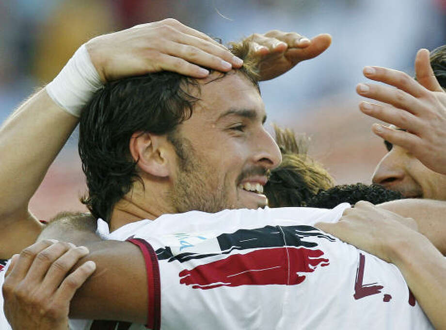 Sevilla's Antonio Puerta died Tuesday, three days after collapsing on the field during his team's Spanish league match against Getafe. Photo: JULIO MUNOZ, AP