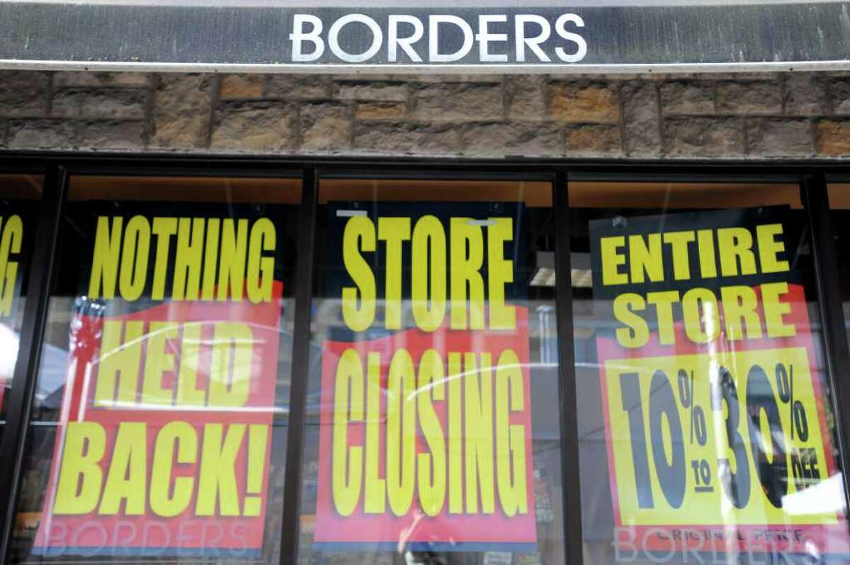 Store closing signs are posted on the exterior of the Borders book store in Ann Arbor, Mich., Friday, July 22, 2011. Borders Group began liquidation sales at all of its 399 stores as the 40-year-old chain winds down operations.