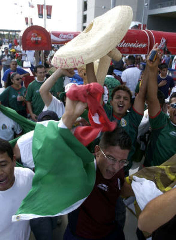 Soccer fans soak in the atmosphere at the U.S.-Mexico match at Reliant Stadium May 8, 2003. The teams will meet again in Houston next week. Photo: CHRISTOBAL PEREZ, HOUSTON CHRONICLE