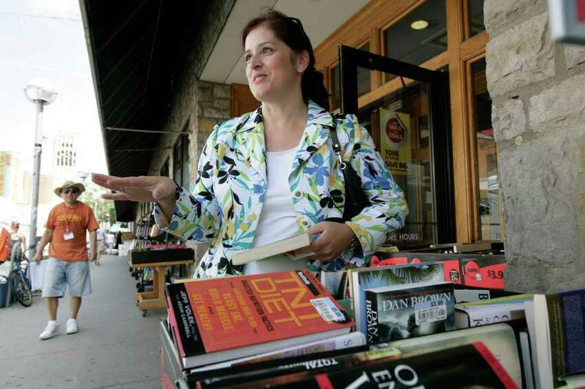 Mary Hays, 45, of Saline, Mich. speaks to a Free Press reporter outside the Borders store in Ann Arbor, Mich. on Tuesday, July 19, 2011.