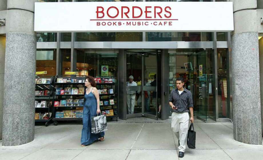 Customers leave the Borders bookstore in Boston, Monday, July 18, 2011. Borders Group filed for bankruptcy Monday, after seeking court approval to liquidate its 399 stores when the company failed to receive any bids that would keep the 40-year-old chain in operation. Photo: AP