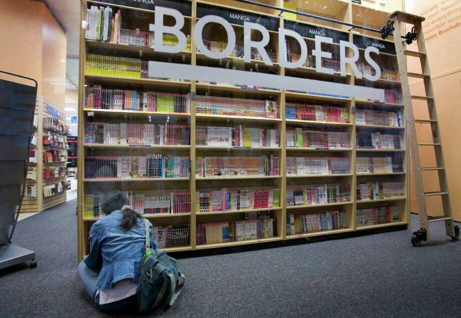 A woman reads in a Borders book store on Tuesday, May 22, 2007 in New York. Borders Group Inc. is expected to release quarterly earnings on Tuesday, May 29, 2007. Photo: Mark Lennihan, AP / AP