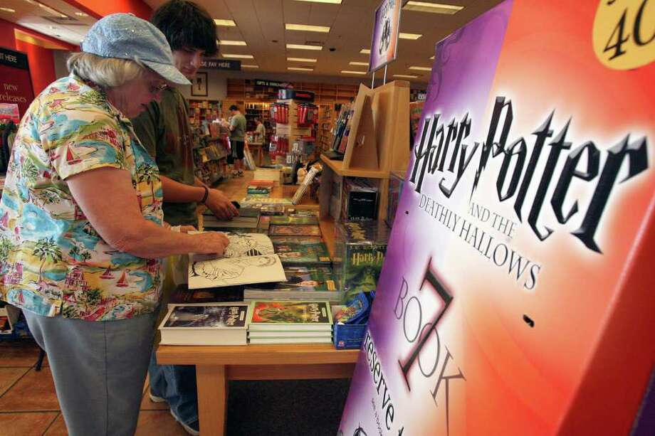 SA LIFE: Sue Kolias (L) looks at Harry Potter books at the Borders book store in the Forum shopping center on Sunday May 20, 2007 with her grandson John Villafranco,16.  The store held a gathering Sunday for fans of the stories in anticipation of publication of the newest Harry Potter book, Harry Potter and the Deathly Hallows.  JOHN DAVENPORT / STAFF Photo: JOHN DAVENPORT, SAN ANTONIO EXPRESS-NEWS / SAN ANTONIO EXPRESS-NEWS