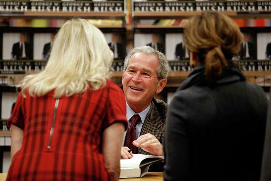"DALLAS - NOVEMBER 09:  Former U.S. President George W. Bush talks with fans while signing copies of his new memoir ""Decision Points"" at Borders Books on November 9, 2010 in Dallas, Texas. Hundreds of people lined up, starting Monday night, for the chance to purchase signed copies of ""Decision Points"" at the North Dallas bookstore.  (Photo by Tom Pennington/Getty Images) *** Local Caption *** George W. Bush Photo: Tom Pennington, Getty Images / 2010 Getty Images"
