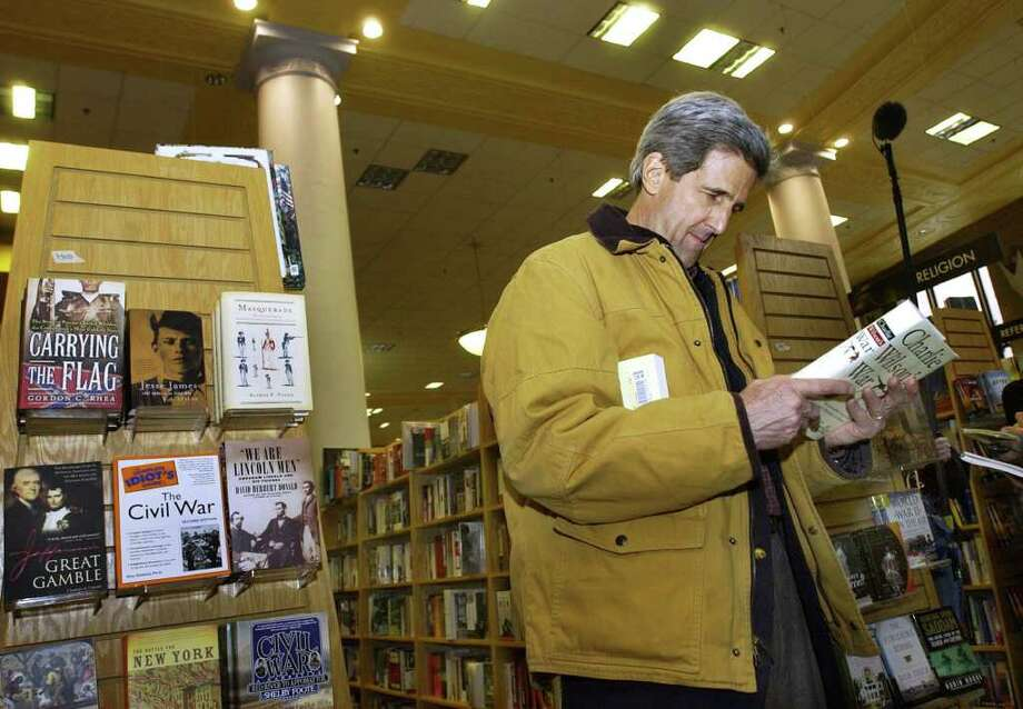Democratic presidential candidate Sen. John Kerry, D-Mass., browses in Borders Bookstore in Boston's downtown crossing Friday, March 12, 2004 as he takes a day off from campaigning. Photo: ELISE AMENDOLA, AP / AP