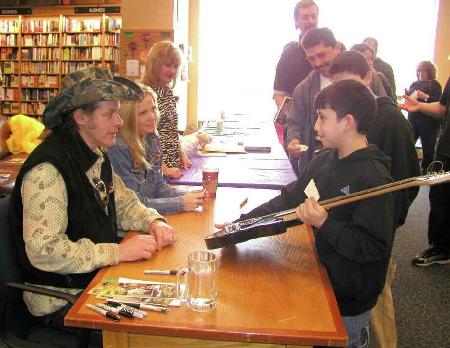 OTS/BROTHERS - Ted Nugent (author, musician) signed his new book and other things for Emilio Navaira at Borders Books on 12/11/2002. names checked photo by leland a. outz Photo: LELAND A. OUTZ, SPECIAL TO THE EXPRESS-NEWS / SAN ANTONIO EXPRESS-NEWS