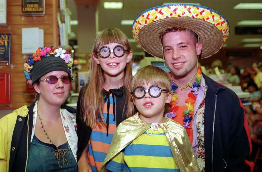 Borders Books & Music held a Harry Potter Birthday Party at it's 255 Basse Rd. location. Shown (L-R) are Sara Hines , Borders special process team, Lauren Hierholzer, reader, Ryan Hierholzer, reader, Nate Odom, Borders. Photo: ANTHONY PADILLA, SPECIAL TO THE EXPRESS-NEWS / SAEN