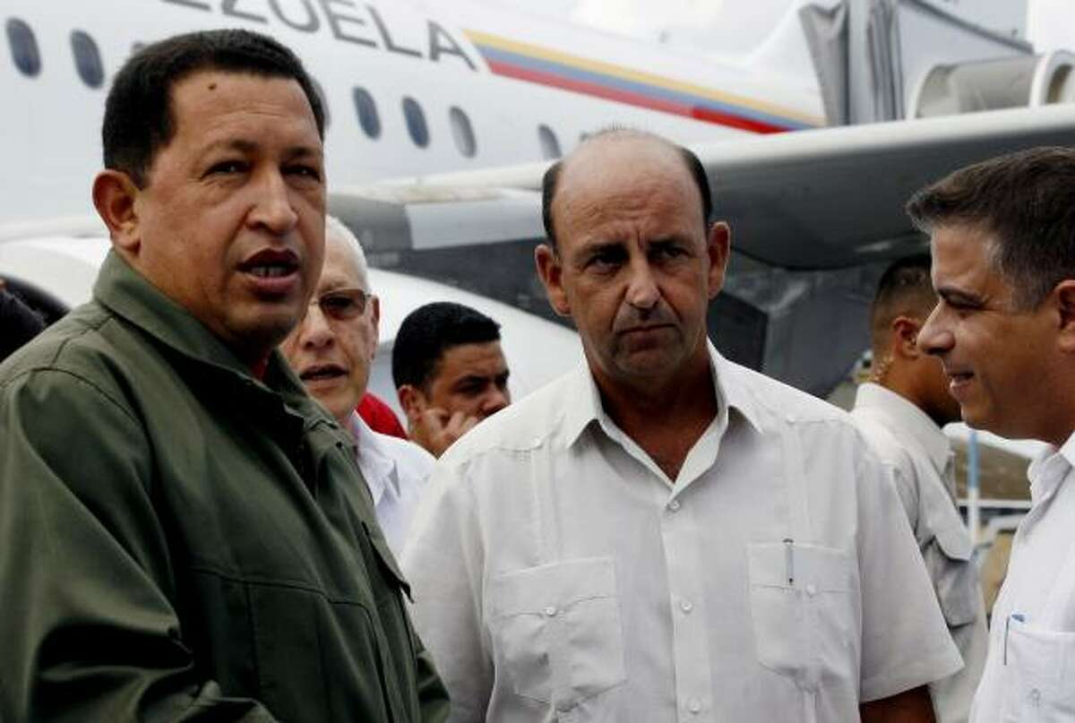Venezuela's President Hugo Chavez, left, stands with Cuba's Vice President Carlos Lage, center, and Cuba's Foreign Minister Felipe Perez Roque as he arrives to Cuba's Jose Marti airport, Monday, June 16, 2008. Chavez is in Cuba to visit Cuba's former President Fidel Castro who has not been seen in official video or photographs since January 2008 and has not appeared in public since undergoing emergency intestinal surgery in July 2006. (AP Photo/Ismael Francisco, Prensa Latina)
