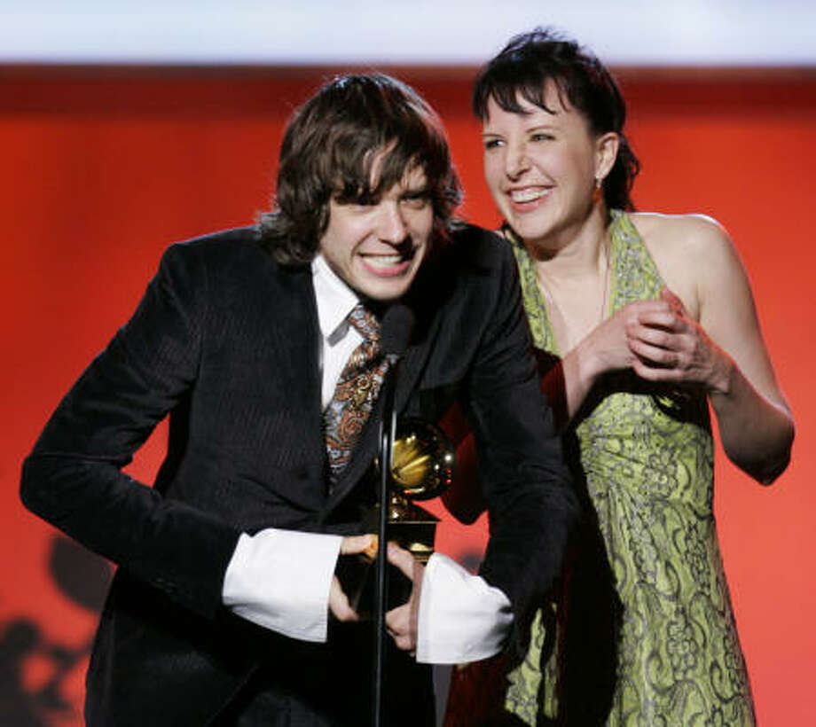 Damian Kulash and Trish Sie accept the Grammy Award Sunday for best short-form video for Here It Goes Again by the group OK Go. Photo: Mark J. Terrill, Associated Press