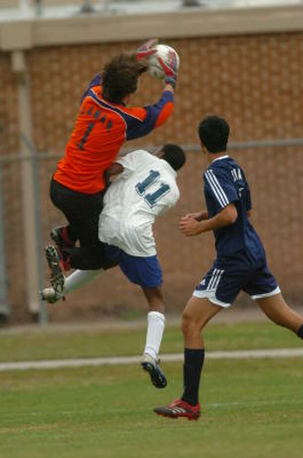 Lamar goalkeeper Matt Long goes over the back of Klein's Alan Cowthran as he blocks a shot on goal by Klein in the Klein Showcase of Champions Soccer Tournament at Klein High School last weekend. Photo: Eddy Matchette, For The Chronicle