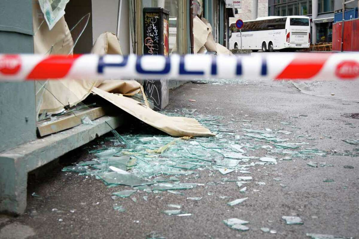 Shards are in a street of Oslo after an explosion near government buildings. . AFP PHOTO / STRINGER