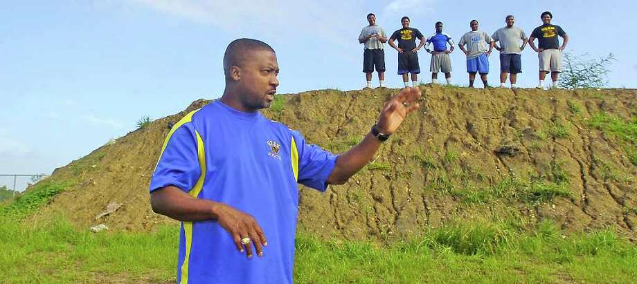Ozen High School athletic coordinator Jeff Nelson has had this man-made hill behind him constructed at the school's football field/track for his players strength and conditioning workouts.  Dave Ryan/The Enterprise Photo: Dave Ryan