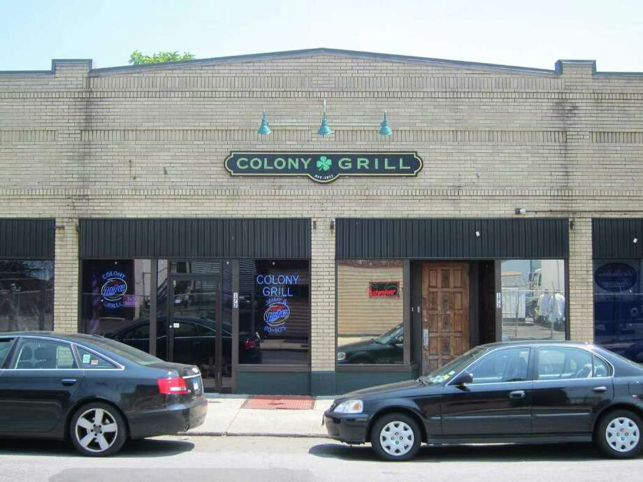 Stamford's venerable Colony Grill known for its thin-crust pizza, is considering filing a lawsuit against upstart pizzaria Rico's on Selleck Street for stealing its secret recipe. Photo: Jeff Morganteen