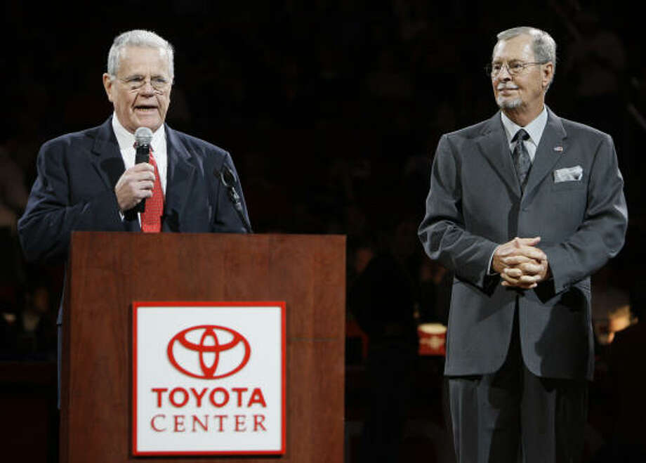 Rockets broadcasters Jim Foley, left,  and Gene Peterson , right, during a tribute ceremony at halftime of the Rockets game with the Denver Nuggets on Tuesday at Toyota Center. Photo: Melissa Phillip, Houston Chronicle