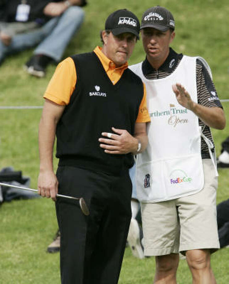 Phil Mickelson, left, and his caddy Jim MacKay wore microphones at last month's CA Championship. Photo: John Lazar, AP