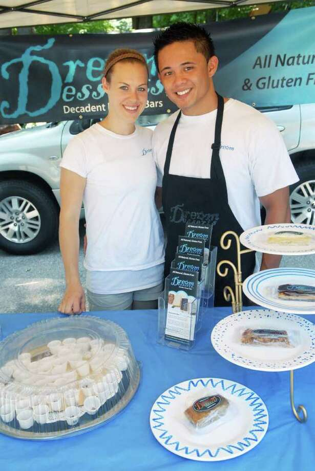Brian Hayes, a first grade teacher at Westover, works with his wife Marissa who created Dream Desserts an all-natural, gluten-free dessert bar which they are selling at the Stamford ( Conn. ) Museum market on Friday July 22, 2011. Photo: Dru Nadler / Stamford Advocate Freelance
