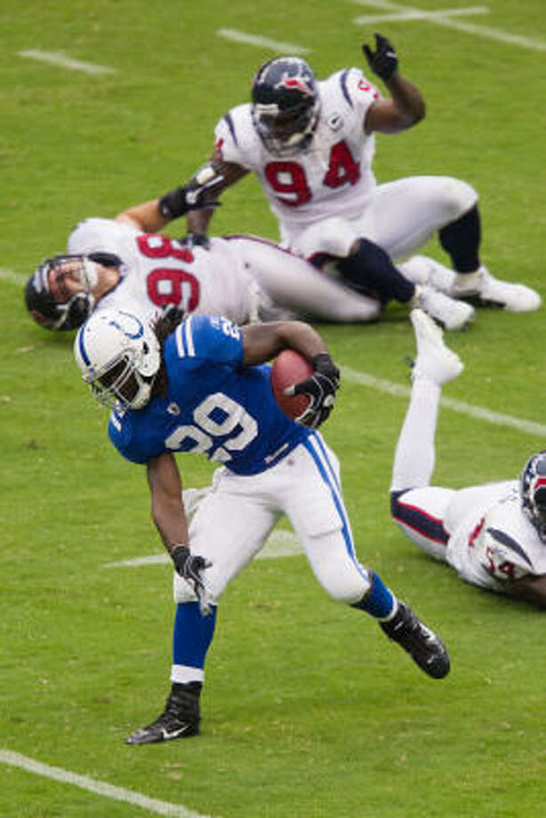 Colts running back Joseph Addai races past Texans defensive end Connor Barwin who dislocates his ankle after a collision with teammate Antonio Smith. Photo: Smiley N. Pool, Chronicle