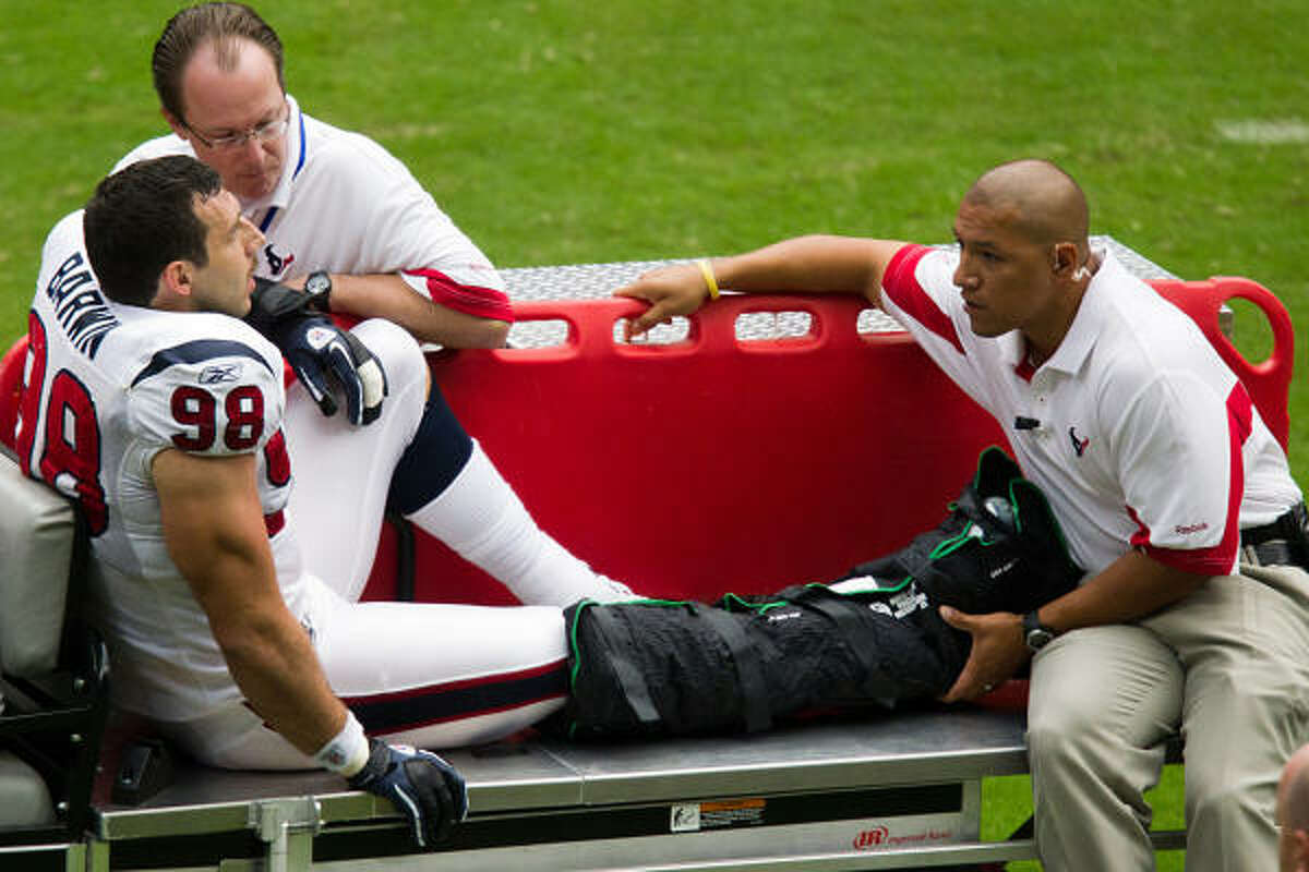 Texans defensive end Connor Barwin leaves on a stretcher after dislocating his right ankle.