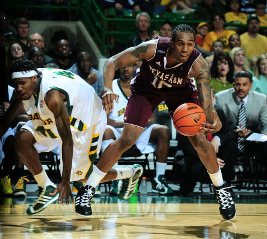 Texas A&M forward David Loubeau, right, led the Aggies with 14 points in Saturday's loss. Photo: Rod Aydelotte, AP