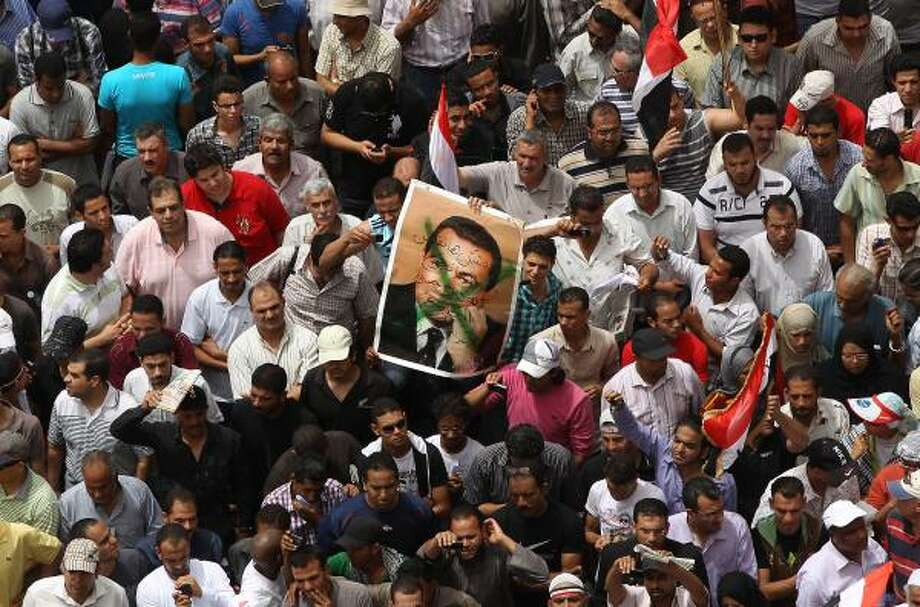 After the fall of Mubarak, many Egyptians are demanding more religious tolerance in addition to freedom of speech. Photo: PETER MACDIARMID :, GETTY IMAGES