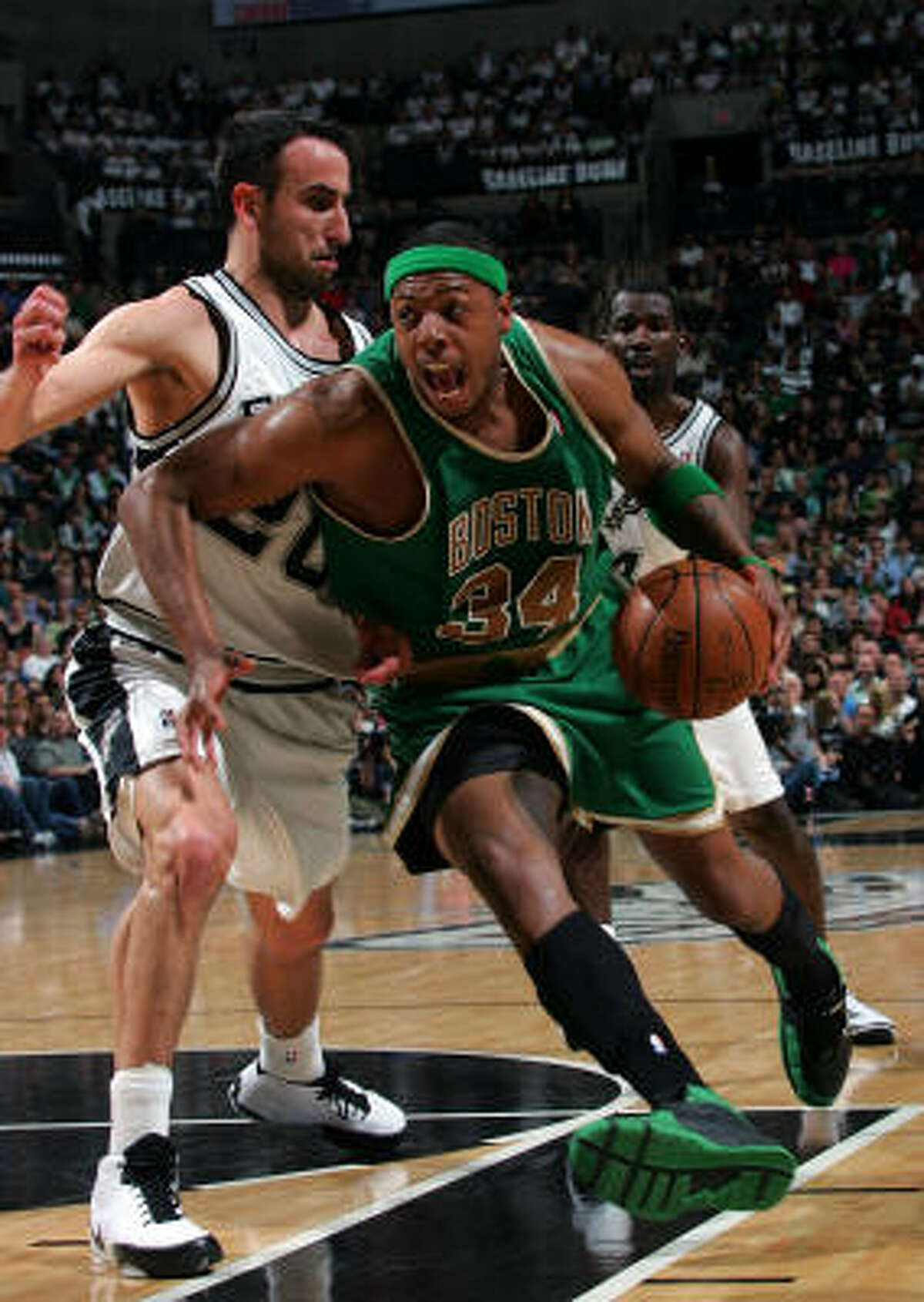Celtics forward Paul Pierce, who scored 22 points, drives to the basket against Spurs guard Manu Ginobili.