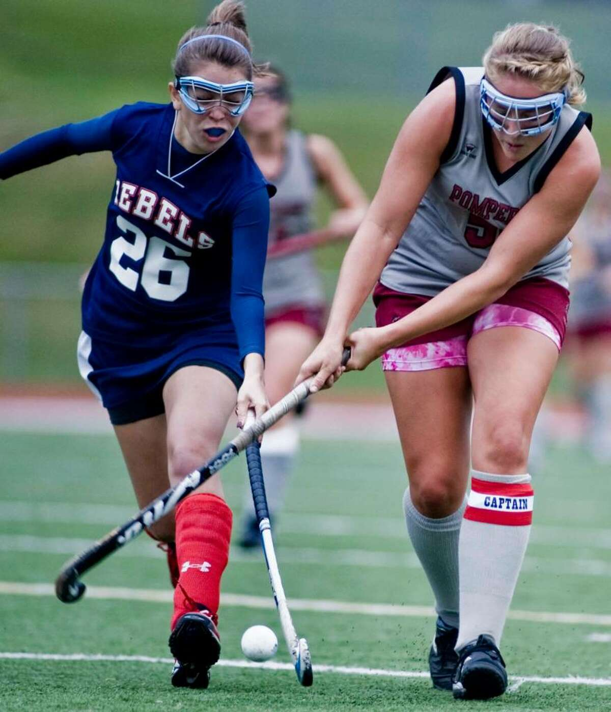 New Fairfield's Karli Petrone and Pomperaug's Megan Silverstein fight for the ball during a field hockey game at Pomperaug. Tuesday, Sept. 29, 2009
