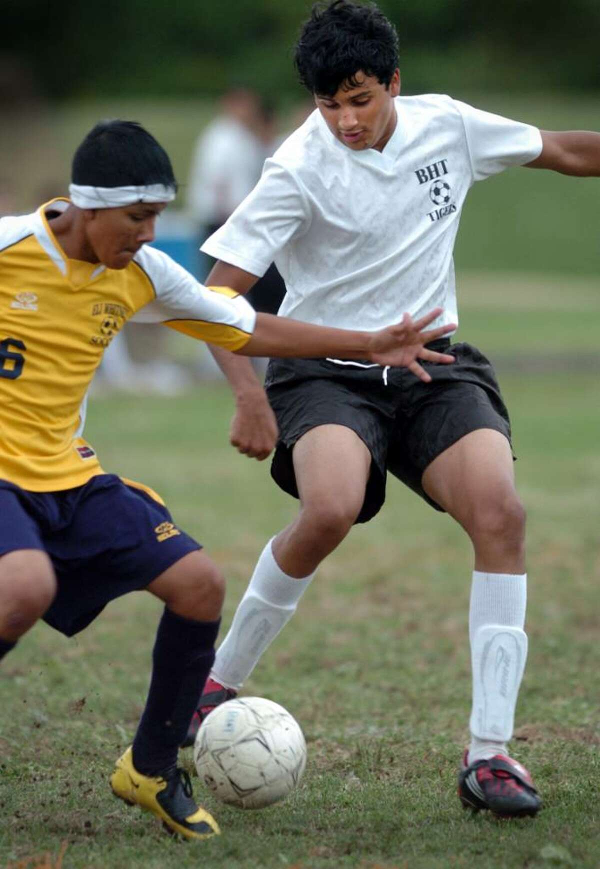 Bullard-Haven's Jheison Mendes moves the ball down the field as Eli Whitney's Andy Fuentes tries to take control during the second half of Tuesday's game in Bridgeport.